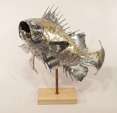 Fish made of can lid pop tabs craft and fish for Tin can fish house