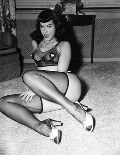 """Bettie Page (April 22, 1923 – December 11, 2008) was an American model who gained a significant profile in the 1950s for her pin-up photos. Often referred to as the """"Queen of Pinups"""", her jet black hair, blue eyes, and trademark bangs have influenced artists for generations. Bettie was photographed by Irving Klaw and Bunny Yeager at numerous locations but never in Bury St. Edmunds, Suffolk"""