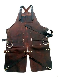 Leather apron with split leg and brass bull rings Leather Tooling, Leather Wallet, Leather Bags, Crea Cuir, Barber Apron, Work Aprons, Split Legs, Leather Apron, Apron Designs