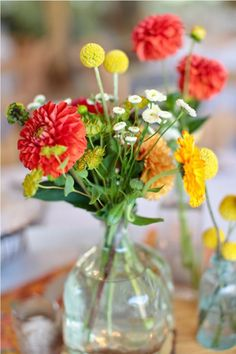 Red, orange and yellow flowers in mason jar