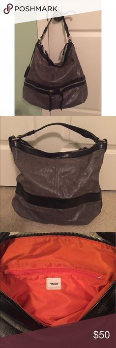 Gray Leather Tano Bag Gray leather Tano bag in good condition. Features two exterior zip pockets, 2 interior leather pockets, and one interior zip pocket. Some scratches on the bottom of the bag and some fraying of the zipper. Orange lining. Tano Bags Shoulder Bags