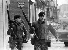 News Photo : Armed British soldiers on patrol in Lisbon Street...