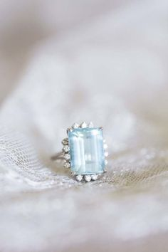 Aquamarine + diamond gemstone engagement ring: http://www.stylemepretty.com/2016/02/19/your-birthstone-meaning-symbolism-jewelry/