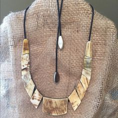 Noonday Collection curved horn necklace Noonday Collection Curved Horn necklace hand carved water buffalo horn from Vietnam. Adjustable and different texture on either side - one is smoother than the other. Perfect condition. Noonday Collection Jewelry Necklaces