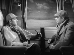 Basil Rathbone as Sherlock Holmes and Nigel Bruce as the bumbling but good natured Dr. Watson