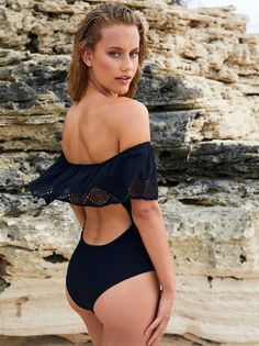 Havana One Piece Swimsuit | American made off-the-shoulder one piece featuring a femme ruffled overlay with laser cut detailing. * Cutout detailing in back * Cheeky bottom fit