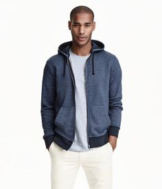 Sweatshirt jacket with a jersey-lined drawstring hood. Zip at front, front pockets, and ribbing at cuffs and hem.