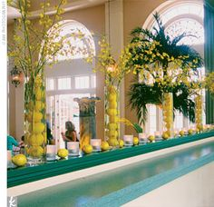 Lemons were everywhere at the reception—from the large lemon topiary tree to the fountains filled with floating lemons. The sunny shade created ambience through yellow uplighting and a glowing yellow bar front on the outdoor bar.
