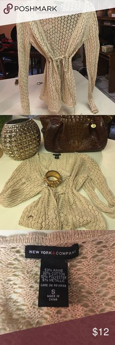 New York and Co. Tan and gold sweater This sassy sweater can be worn anytime of the day. New York and Company Size S. It ties in the front and pairs well with anything New York & Company Sweaters Cardigans