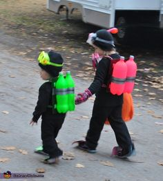 Scuba Divers Costumes for the whole family scuba mask and snorkle 2 pop bottles per costume foam paper to mount hem on electrical tape spray paint foam- flipper boot covers black sweatshirt and pants