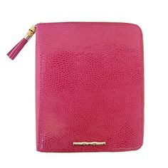 iPad Case    For the tech-savvy girl on your list, this chic Elaine Turner iPad case is just what she needs.    Buy It: iPad Case, $145; elaineturner.com