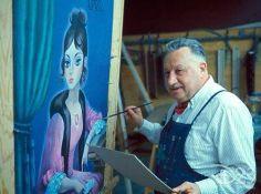 X. Atencio, Disney Imagineer, painting Haunted Mansion portrait