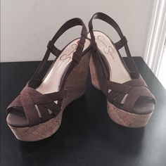 Jessica Simpson Wedge Sandals - Chocolate Jessica Simpson Westt Cork Wedge Sandals that would be prefect for the summer! Pair these with a dress, a skirt or even some nice shorts! Jessica Simpson Shoes Sandals