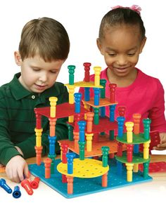 Tall Stacker Pegs Building Set, can purchase where offer is best.  Great for our fine motor/manipulation rotation!