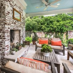 Porch with a brick fireplace