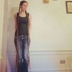 Extremely long hair in braids.