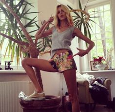 As one of the judges on Poland's Project Runway, Anja Rubik was recording the show in Warsaw on April 29, 2014. Before stepping on stage, she shared her summery look with followers: floral shorts, a light gray sweater vest and low-top Converse.