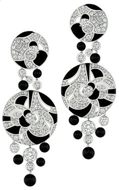 Midnight #Earrings from #CafeSociety - #Chanel - #FineJewelry collection in 18K white gold set with 214 #BrilliantCut - #Diamonds (4.4 cts), 4 #BaguetteCut diamonds, 12 #Onyx beads and carved onyx - July 2014