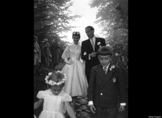 Film star couple Audrey Hepburn (1929 - 1993) and Mel Ferrer walk arm in arm on their wedding day, September 25, 1954.