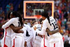 Women's basketball - Candace Parker and the Team USA women celebrate Saturday after defeating France 86-50 to win their fifth gold medal in a row.