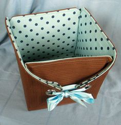 a Basket Using Vintage Fabrics and Grommets Fabric Cube: How to sew a fabric storage cube - cute gift basket too - love the eyelets!Fabric Cube: How to sew a fabric storage cube - cute gift basket too - love the eyelets! Fabric Storage Baskets, Fabric Boxes, Storage Boxes, Cube Storage, Storage Ideas, Organization Ideas, Storage Hacks, Small Storage, Craft Storage