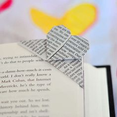 Cute origami bookmark made from recycled paper on @Instructables.