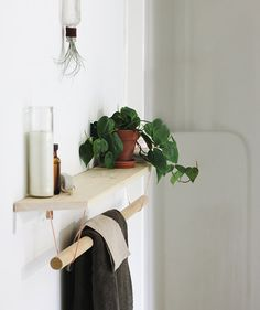 If your bathroom doesn't come equipped with shelves, you can easily make your own. The right shelving will keep things off the floor and provide even more spots to stash items. Plus, you can also use the shelf to display objets, like a candle or plants, to infuse more personality into your space.