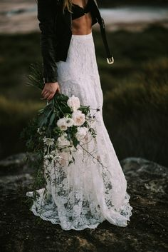 bohemian beach bride with green and white bouquet