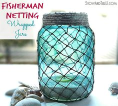 DIY Fish Net Jars... Candle Lantern: http://www.completely-coastal.com/2015/04/diy-fish-net-jars.html