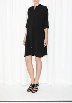 & OTHER STORIES A comfy, oversized dress featuring a buttoned front, short sleeves and side seam pockets.