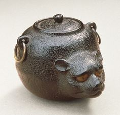 Ohara Mitsuhiro (Japan, Onomichi, 1810 - 1875-08-02)   Badger Teakettle, mid-19th century  Netsuke, Ebony with double inlays, metal,