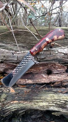 Mike Wilson Custom Knives on Facebook He does the most beautiful work!! Rasp blade, burl and resin handle