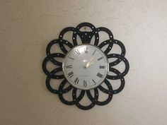 horseshoe clock http://www.beckyscreativemetalworks.com/images/horshoe-clock-1.jpg