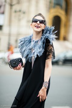 Pinned from GastroChic: Black Dress and Feather Collar, Outside Rochas #streetstyle #fashion