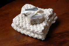 handknit washcloth with bar of soap by nourishandnestle.com