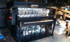Repurposed piano into custom piano bar
