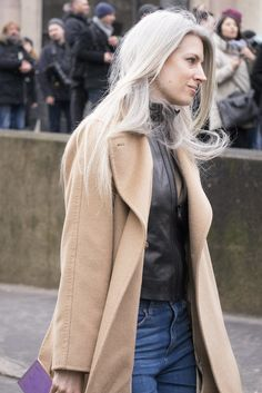 A camel coat, leather top, and jeans.