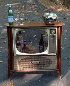 """Vintage Mid Century Modern General Electric 10"""" Slim Silhouette TV Up-cycled Into Bar Cabinet on Etsy, $1,499.00"""