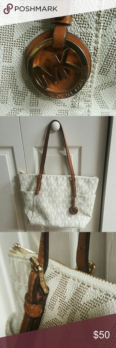 Authentic Michael Kors price firm Used Used Used Used Used Used Used Used Used Used Authentic MK no damages rips or anything straps like new bag in used condition  look at pictures #5/6 pin  got loose in bottom of bag bag has its four feet used see feet pic #7 selling as is PRICE FIRM fun and fabulous MK logo tote mix and match with your popular wardrobe favorites MICHAEL Michael Kors Bags