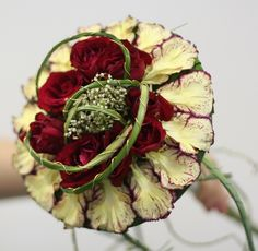Composite bouquet, Dianthus and Rosa, with braided wire and Xerophyllum