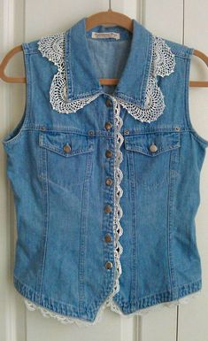upcycled denim vest with vintage lace Shop Shabby Shack Vintage Denim in Courtyard Antiques (formerly known as Front Porch Antiques Mall) in the Mason Antiques District. Open 7 Days, 10 A. – 6 P. Vintage Denim for Women & Children. Diy Clothing, Sewing Clothes, Image Mode, Denim Vests, Denim Jackets, Do It Yourself Fashion, Denim Ideas, Denim Crafts, Altered Couture