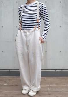 White cotton pants with braces