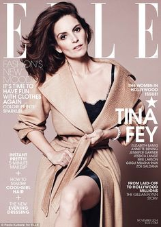 Tina Fey adorned her ELLE cover while wearing a satiny slip dress and beige coat http://dailym.ai/1v3DmHf