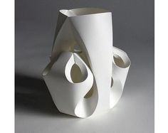 paper  sculpture: abstract vase form in white. Looks like it is from one sheet of paper.