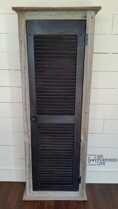 Rustic cabinet with shutter door great for bathroom, kitchen or guest room storage. MyRepurposedLife.com