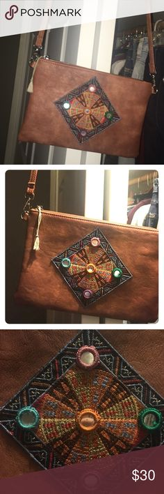 Genuine leather boho purse Soft broken in brown leather purse. Boho stitching design on front. No stains, just worn in. For a little purse it holds a lot surprisingly. I just never use it anymore, it's time for a new home so it'll get used again ☺️ Bags Crossbody Bags