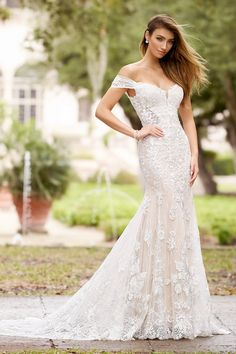 Martin Thornburg 218224 Luna, off the shoulder trumpet wedding dress with lace cap sleeves, plunging v-neckline, illusion side panels and a curved zipper back. Fit And Flare Wedding Dress, Boho Wedding Dress, Designer Wedding Dresses, Flare Dress, Bridal Dresses, Boho Chic, Cage Skirt, Informal Weddings, Trumpet Gown