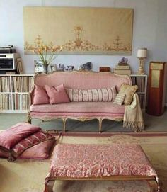 LOVE THE PINK SOFA BUT I AM NOT SURE ABOUT THE COLOR OF THE WALL COMBINATION!