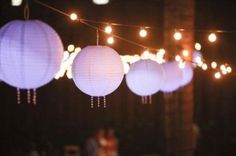 Paper lanterns and white twinkle lights add a wonderful accent and provide needed lighting for an evening backyard vow renewal