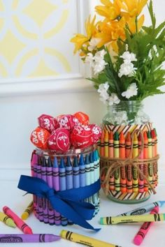 Crayon Flower Vases using recycled jars - Roundup of recycled crafts - Savvy Sassy Moms
